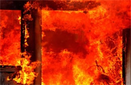 Close Up of Fire Through a Door Way Engulfed in Flame